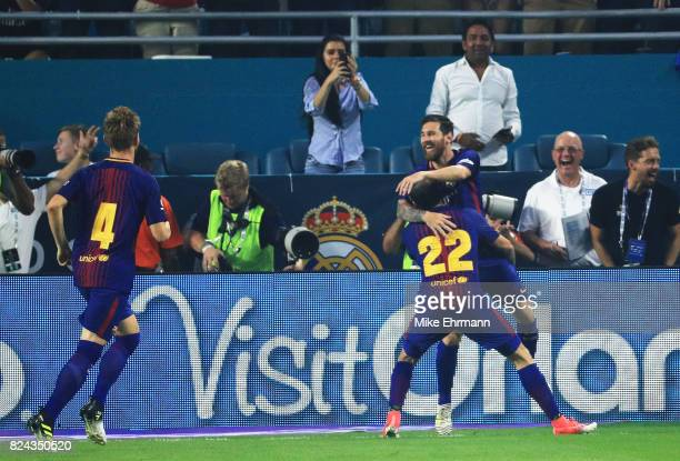 Lionel Messi of Barcelona celebrates his goal with teammates in the first half against the Real Madrid during their International Champions Cup 2017...