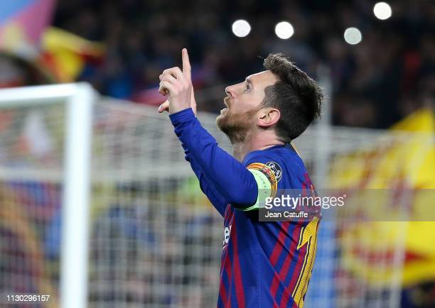 Lionel Messi of Barcelona celebrates his second goal during the UEFA Champions League Round of 16 Second Leg match between FC Barcelona and Olympique...