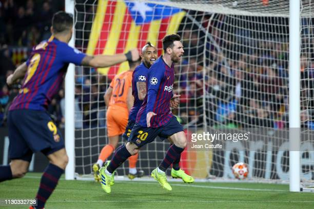 Lionel Messi of Barcelona celebrates his second goal with Arturo Vidal during the UEFA Champions League Round of 16 Second Leg match between FC...