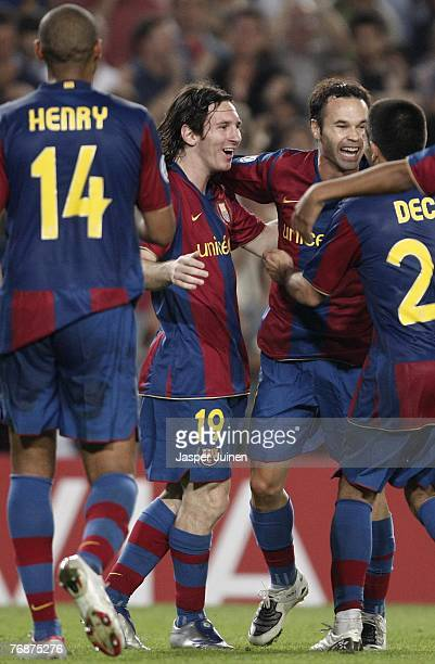 Lionel Messi of Barcelona celebrates his second goal with his teammates during the UEFA Champions League Group E match between Barcelona and Lyon at...