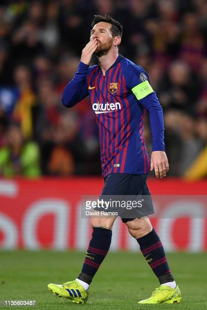 Lionel Messi of Barcelona celebrates scores his team's first goal from a penalty during the UEFA Champions League Round of 16 Second Leg match...