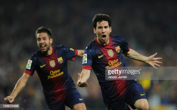Lionel Messi of Barcelona celebrates scoring beside his teammate Jordi Alba during the la Liga match between FC Barcelona and Real Madrid at the Camp...
