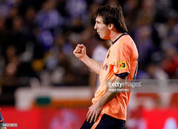 Lionel Messi of Barcelona celebrates scoring during the La Liga match between Deportivo La Coruna and Barcelona at the Riazor stadium on December 5,...