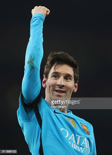 Lionel Messi of Barcelona celebrates scoring his second goal during the UEFA Champions League round of 16 first leg match between Arsenal and...