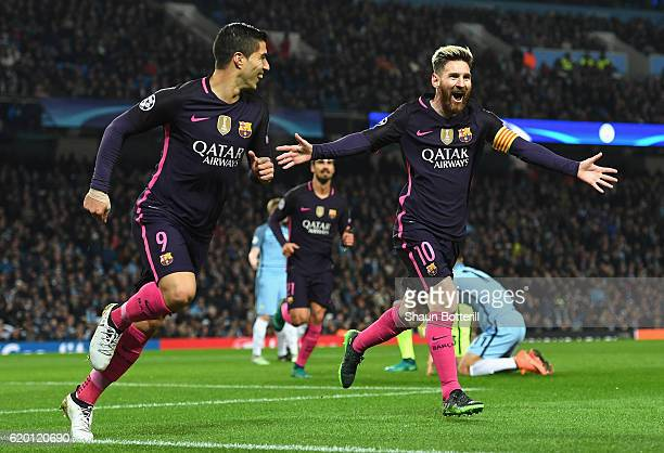 Lionel Messi of Barcelona celebrates scoring his sides first goal with Luis Suarez of Barcelona during the UEFA Champions League Group C match...