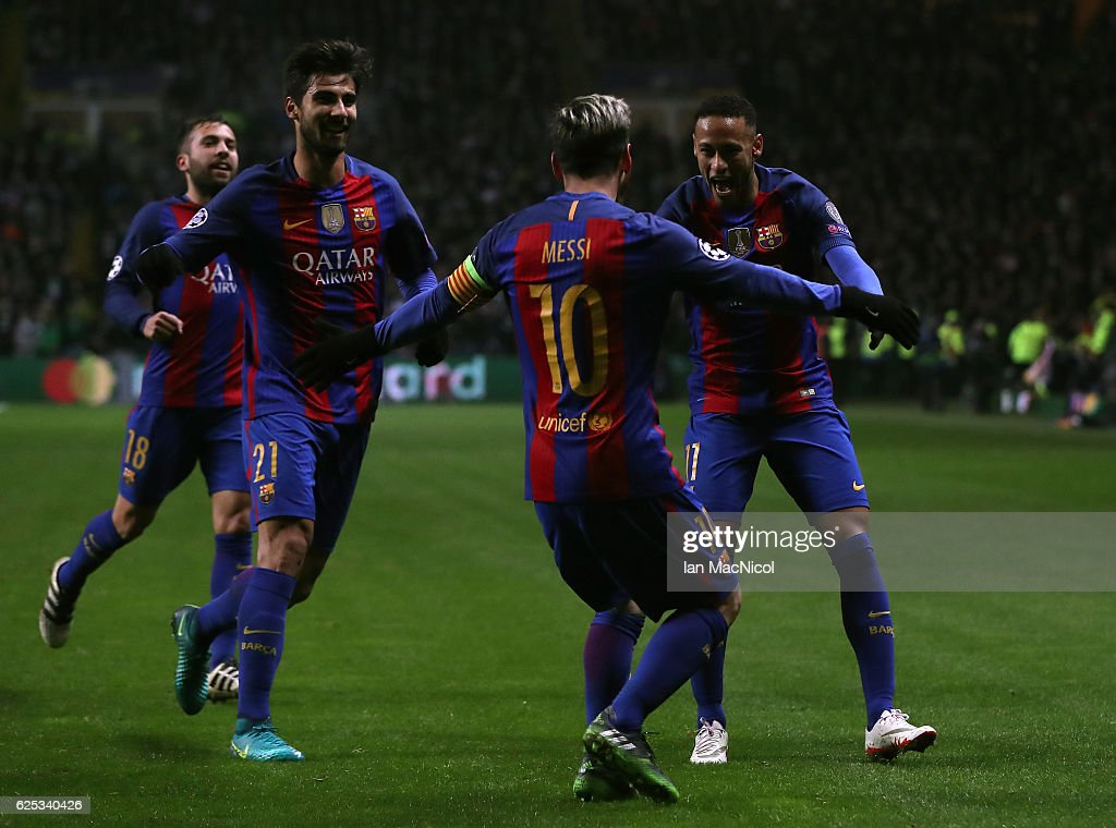 Lionel Messi of Barcelona (C) celebrates scoring his sides first goal with his Barcelona team mates during the UEFA Champions League Group C match between Celtic FC and FC Barcelona at Celtic Park Stadium on November 23, 2016 in Glasgow, Scotland.
