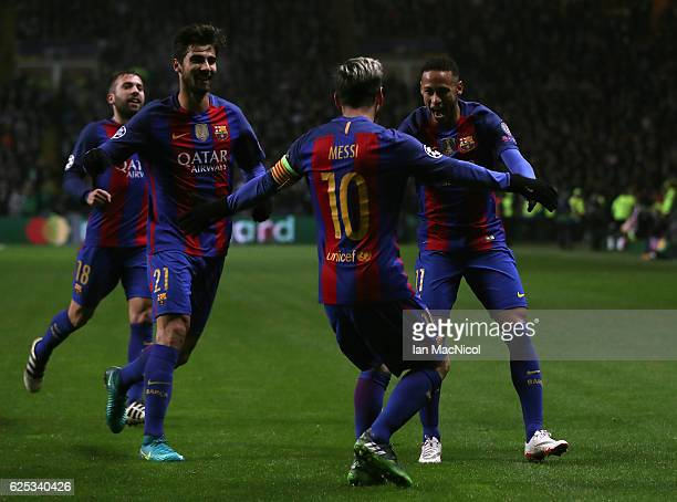 Lionel Messi of Barcelona celebrates scoring his sides first goal with his Barcelona team mates during the UEFA Champions League Group C match...