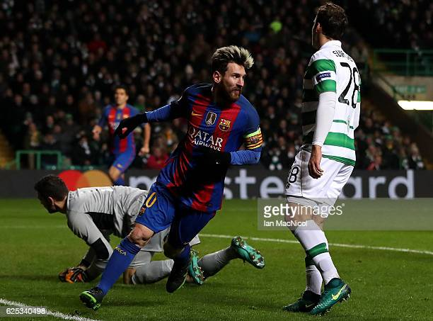 Lionel Messi of Barcelona celebrates scoring his sides first goal during the UEFA Champions League Group C match between Celtic FC and FC Barcelona...