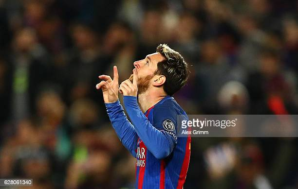 Lionel Messi of Barcelona celebrates scoring his sides first goal during the UEFA Champions League Group C match between FC Barcelona and VfL...