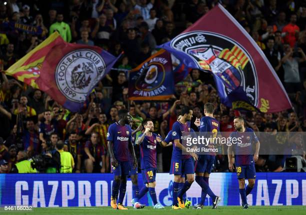Lionel Messi of Barcelona celebrates scoring his sides first goal with his Barcelona team mates during the UEFA Champions League Group D match...