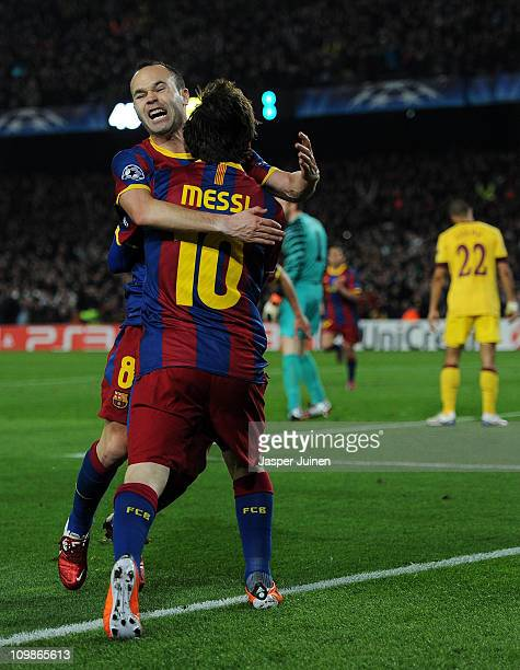 Lionel Messi of Barcelona celebrates scoring his sides opening goal with his teammate Andres Iniesta during the UEFA Champions League round of 16...