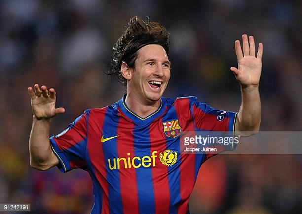 Lionel Messi of Barcelona celebrates scoring his sides opening goal during the Champions League group F match between Barcelona and Dynamo Kiev at...