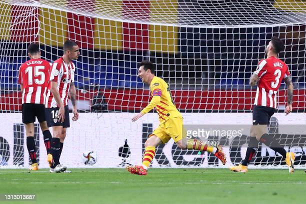Lionel Messi of Barcelona celebrates scoring his sides third goal as players from Athletic Club stand dejected during the Copa del Rey Final match...