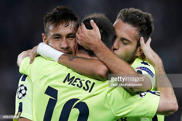 Lionel Messi of Barcelona celebrates scoring his teams first goal of the game with Neymar and Jordi Alba during the Group F UEFA Champions League...