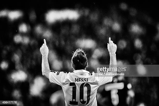 Lionel Messi of Barcelona celebrates scoring his teams first goal of the game during the Group F UEFA Champions League match between Paris...