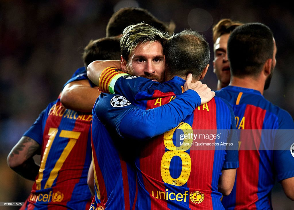 Lionel Messi of Barcelona celebrates scoring his team's first goal with his teammate Andres Iniesta during the UEFA Champions League Group C match between FC Barcelona and VfL Borussia Moenchengladbach at Camp Nou on December 6, 2016 in Barcelona.
