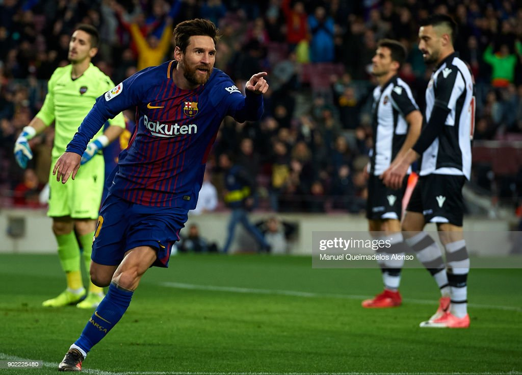 Lionel Messi of Barcelona celebrates scoring his team's first goal during the La Liga match between Barcelona and Levante at Camp Nou on January 7, 2018 in Barcelona, Spain.