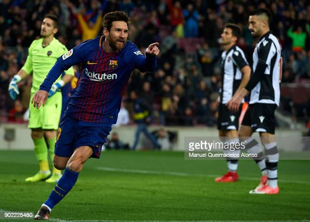 Lionel Messi of Barcelona celebrates scoring his team's first goal during the La Liga match between Barcelona and Levante at Camp Nou on January 7...