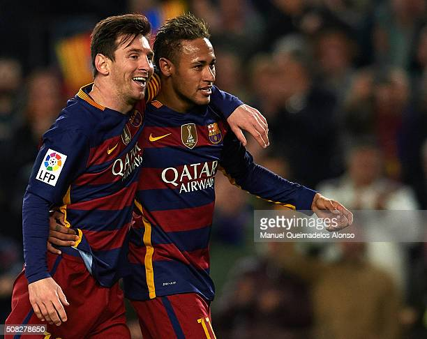 Lionel Messi of Barcelona celebrates scoring his team's fourth goal with his teammate Neymar JR during the Copa del Rey Semi Final first leg match...