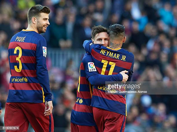 Lionel Messi of Barcelona celebrates scoring his team's fourth goal with his teammate Neymar JR during the La Liga match between FC Barcelona and...