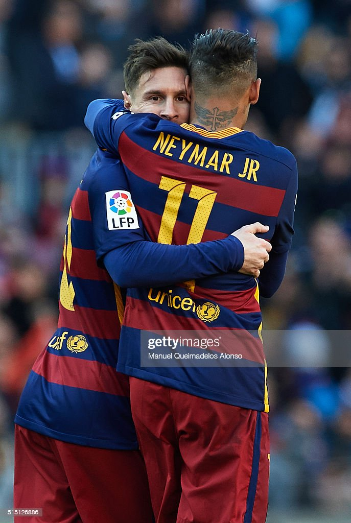 Lionel Messi of Barcelona celebrates scoring his team's fourth goal with his teammate Neymar JR during the La Liga match between FC Barcelona and Getafe CF at Camp Nou on March 12, 2016 in Barcelona, Spain.