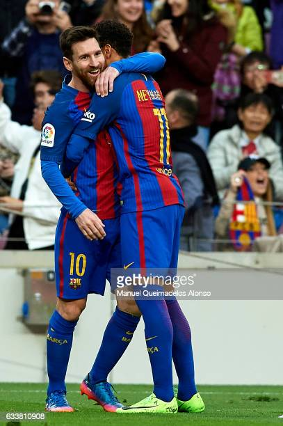 Lionel Messi of Barcelona celebrates scoring his team's second goal with his teammate Neymar JR during the La Liga match between FC Barcelona and...