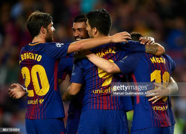 Lionel Messi of Barcelona celebrates scoring his team's second goal with his teammates Luis Suarez Sergi Roberto and Paulinho during the UEFA...