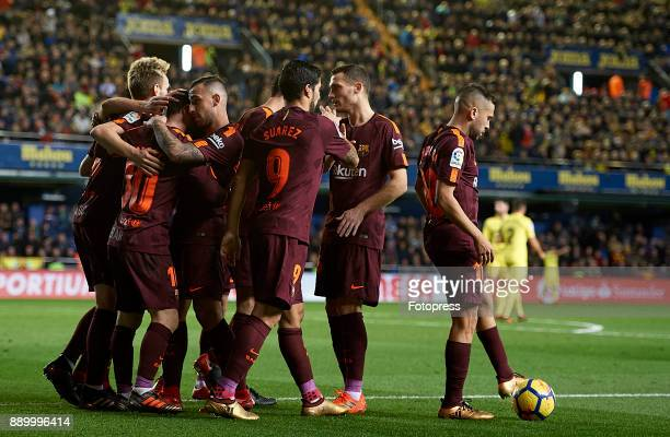 Lionel Messi of Barcelona celebrates scoring his team's second goal with his teammates during the La Liga match between Villarreal and Barcelona at...