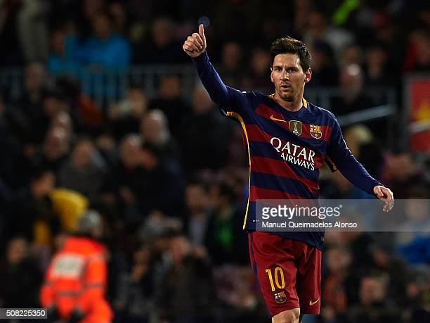 Lionel Messi of Barcelona celebrates scoring his team's third goal during the Copa del Rey Semi Final first leg match between FC Barcelona and...