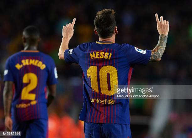 Lionel Messi of Barcelona celebrates scoring his team's third goal during the La Liga match between Barcelona and Espanyol at Camp Nou on September 9...
