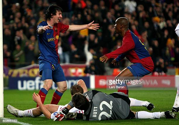 Lionel Messi of Barcelona celebrates scoring his team's third goal with team mate Samuel Eto'o next to goalkeeper Hans Joerg Butt of Munich during...