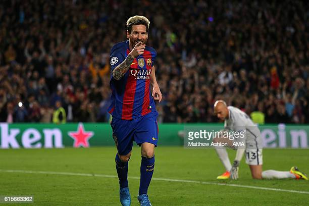Lionel Messi of Barcelona celebrates scoring his team's third goal to seal his hattrick and make the score 30 during the UEFA Champions League match...