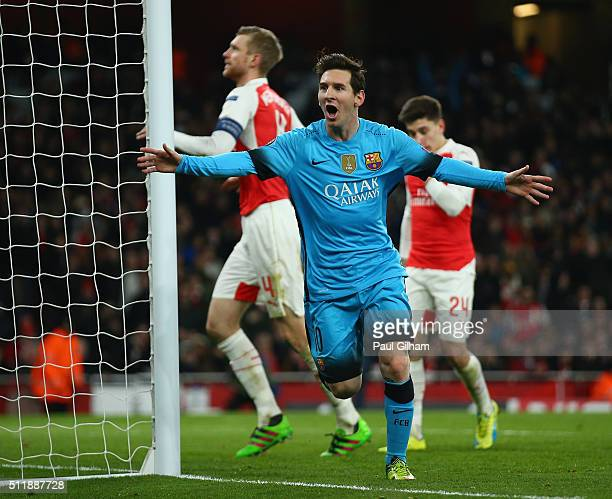 Lionel Messi of Barcelona celebrates scoring the opening goal during the UEFA Champions League round of 16 first leg match between Arsenal and...
