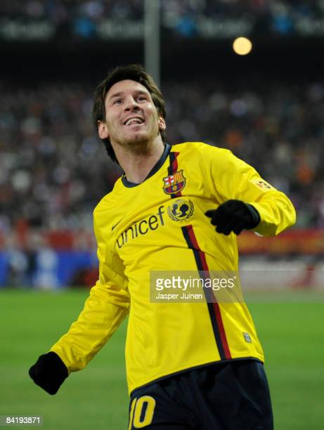 Lionel Messi of Barcelona celebrates scoring the opening goal during the round of last 16 Copa del Rey match between Atletico Madrid and Barcelona at...