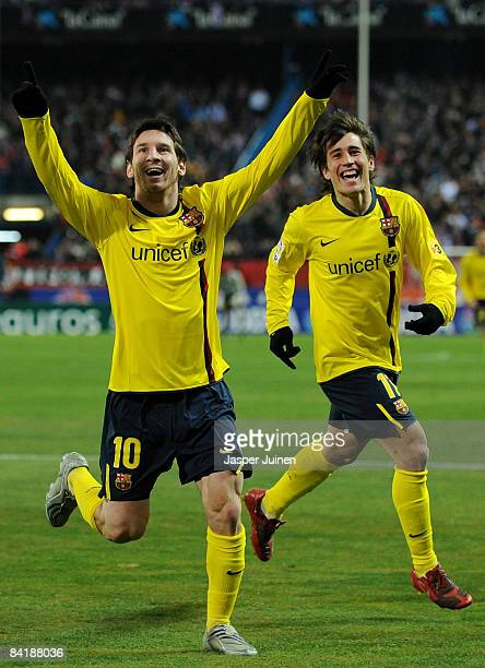 Lionel Messi of Barcelona celebrates scoring the opening goal with his teammate Bojan Krkic during the round of last 16 Copa del Rey match between...