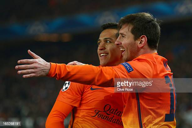Lionel Messi of Barcelona celebrates scoring with teammate Alexis Sanchez during the UEFA Champions League Quarter Final match between Paris...