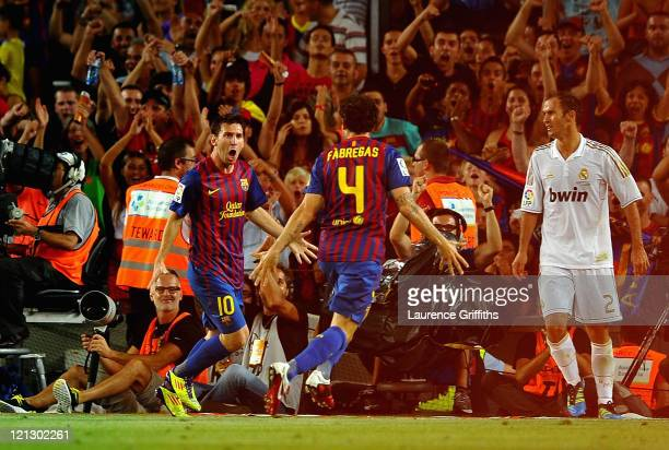 Lionel Messi of Barcelona celebrates the winning goal with Cesc Fabregas during the Super Cup second leg match between Barcelona and Real Madrid at...