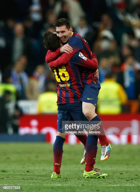 Lionel Messi of Barcelona celebrates victory with Jordi Alba of Barcelona after the La Liga match between Real Madrid CF and FC Barcelona at the...