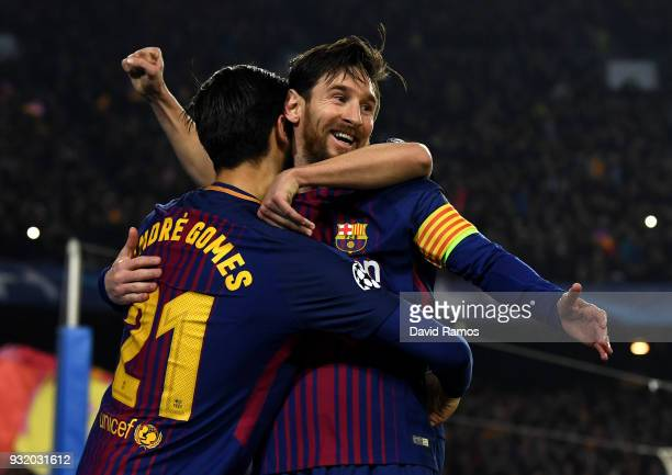 Lionel Messi of Barcelona celebrates with Andre Gomes as he scores their third goal during the UEFA Champions League Round of 16 Second Leg match FC...
