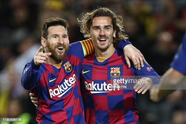 Lionel Messi of Barcelona celebrates with Antoine Griezmann of FC Barcelona after scoring his team's second goal during the UEFA Champions League...
