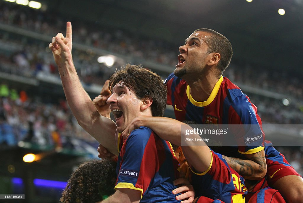 Lionel Messi of Barcelona celebrates with Dani Alves after scoring his second goal during the UEFA Champions League Semi Final first leg match between Real Madrid and Barcelona at Estadio Santiago Bernabeu on April 27, 2011 in Madrid, Spain.