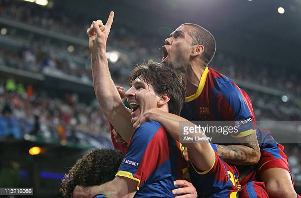 Lionel Messi of Barcelona celebrates with Dani Alves after scoring his second goal during the UEFA Champions League Semi Final first leg match...