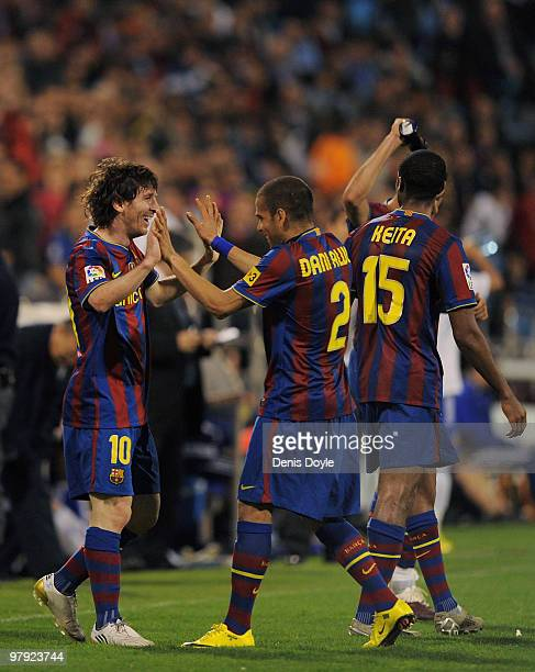 Lionel Messi of Barcelona celebrates with Dani Alves after scoring his third goal during the La Liga match between Real Zaragoza and Barcelona at La...