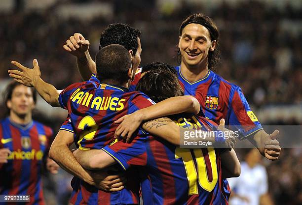 Lionel Messi of Barcelona celebrates with Dani Alves and Zlatan Ibrahimovic after scoring his team's first goal during the La Liga match between Real...