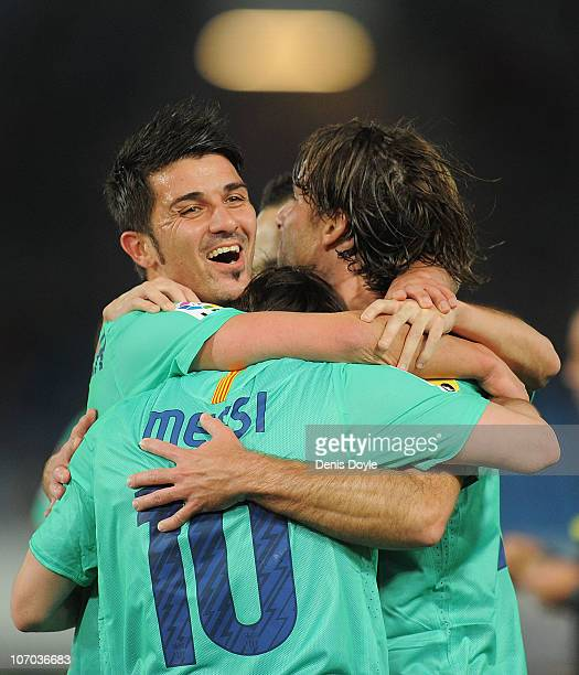 Lionel Messi of Barcelona celebrates with David Villa after scoring Barcelona's opening goal during the La Liga match between UD Almeria and...
