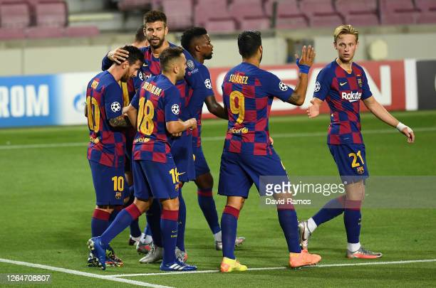 Lionel Messi of Barcelona celebrates with his team after he scores his sides second goal during the UEFA Champions League round of 16 second leg...