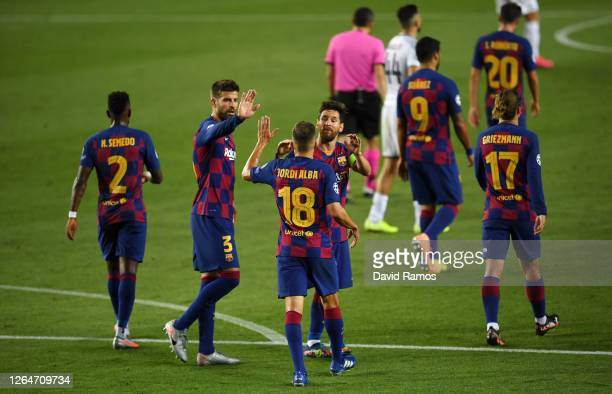 Lionel Messi of Barcelona celebrates with his team after he scores his sides third goal during the UEFA Champions League round of 16 second leg match...