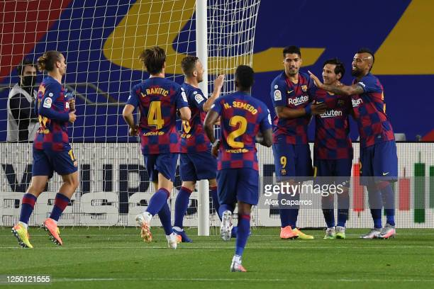 Lionel Messi of Barcelona celebrates with his team after scoring his teams second goal from the penalty spot during the Liga match between FC...