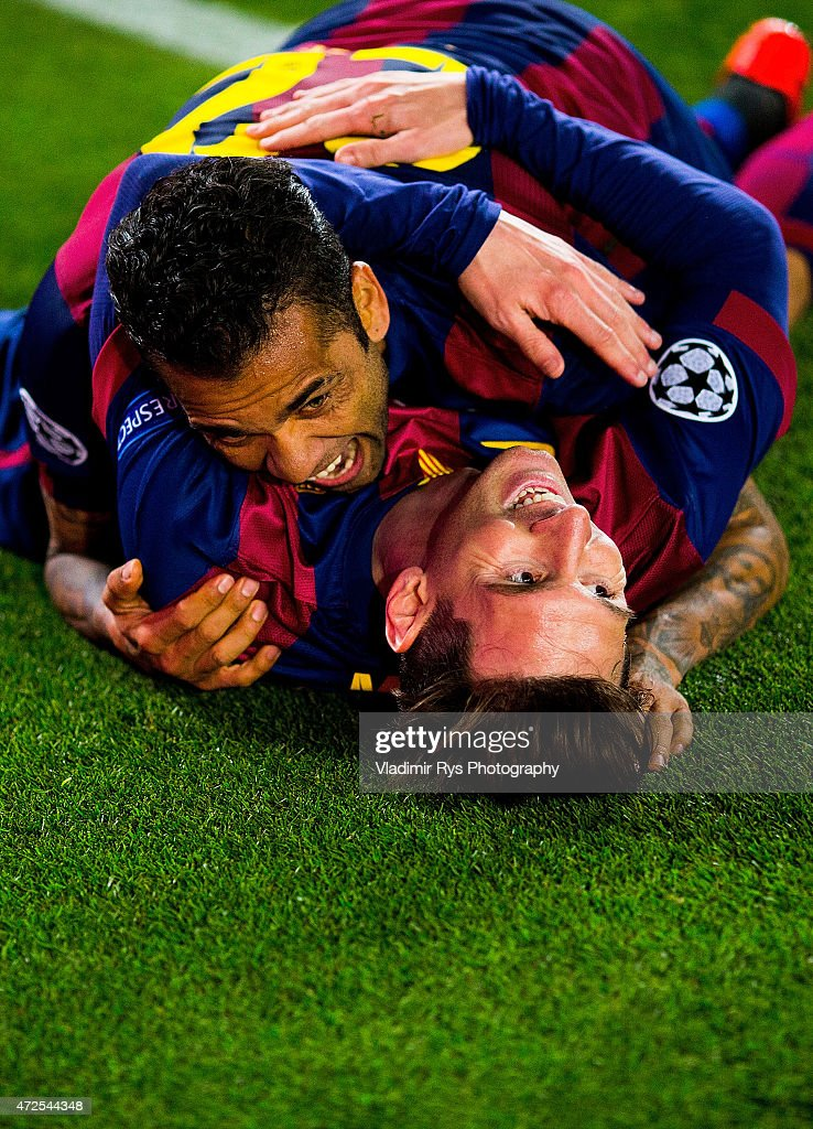 Lionel Messi of Barcelona celebrates with his team mate Daniel Alves after scoring his second goal during the first leg of UEFA Champions League semifinal match between FC Barcelona and FC Bayern Muenchen at Camp Nou on May 6, 2015 in Barcelona, Spain.