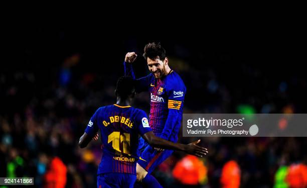 Lionel Messi of Barcelona celebrates with his team mate Ousama Dembele after scoring his team's third goal during the La Liga match between FC...